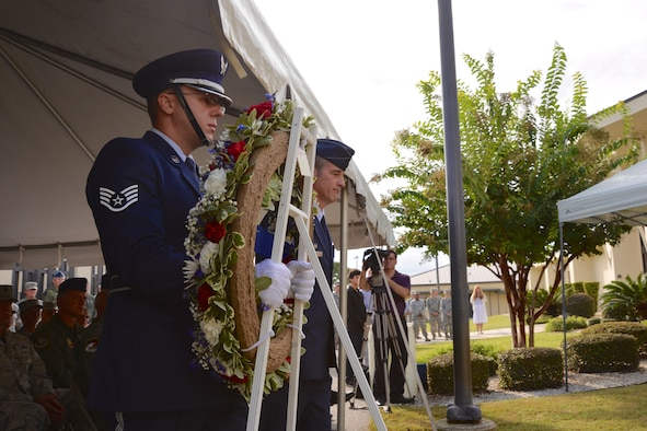 Staff Sgt. Christopher Jones, 601st Air Operations Center Color Guard, and Col. John Ferry, 601st AOC Commander, step forward to place a wreath at the 601st  AOC 9/11 Memorial during a remembrance ceremony  Sept. 11. (Air Force Photo Released/Airman 1st Class Sergio Gamboa)
