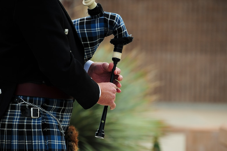 "U.S. Air Force Col. James Clark, 12th Air Force A6 director of communications, plays ""Amazing Grace"" on his bagpipe during a 9/11 remembrance ceremony at Davis-Monthan Air Force Base, Ariz., Sept. 11, 2015. Clark played while a wreath was laid to honor the victims of the Sept. 11, 2001 terrorist attacks. (U.S. Air Force photo by Airman 1st Class Chris Drzazgowski/Released)"