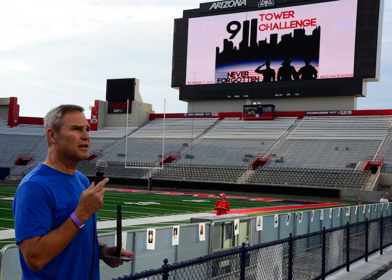 Lt. Gen. Chris Nowland, 12th Air Force (Air Forces Southern) commander, speaks to participants about patriotism during the 9/11 Tower Challenge at the University of Arizona football stadium in Tucson, Ariz., Sept. 11, 2015. The 9/11 Tower Challenge was held to honor those who lost their lives during the Sept. 11, 2001 attacks and to show their support first responders and military members who continue to protect the U.S. from foreign and domestic threats. During the 9/11 Tower Challenge, participants climbed 2,071 steps representing the number of steps that were in the Twin Towers. (U.S. Air Force Photo by Tech. Sgt. Heather R. Redman/Released)