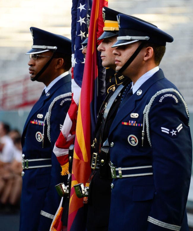 Members of the Davis-Monthan and Tucson Police Department Honor Guard post the colors during the 9/11 Tower Challenge at the University of Arizona football stadium in Tucson, Ariz., Sept. 11, 2015. Members of 12th Air Force (Air Forces Southern) joined the Tucson community to honor those who lost their lives during the Sept. 11, 2001 attacks and to show their support for first responders and military members who continue to protect the U.S. from foreign and domestic threats. During the 9/11 Tower Challenge, participants climbed 2,071 steps representing the number of steps that were in the Twin Towers. (U.S. Air Force Photo by Tech. Sgt. Heather R. Redman/Released)