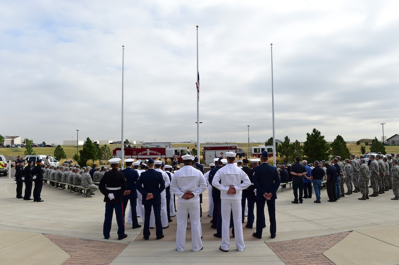 Members of Team Buckley remember those who fell during the events of Sept. 11, 2001, as part of the Patriot Day Ceremony Sept. 11, 2015, at the Headquarters Building on Buckley Air Force Base, Colo. Patriot Day is the national day of service and remembrance, in memory of the thousands killed on U.S. soil in the 9/11 attacks. (U.S. Air Force photo by Senior Airman Phillip Houk/Released)