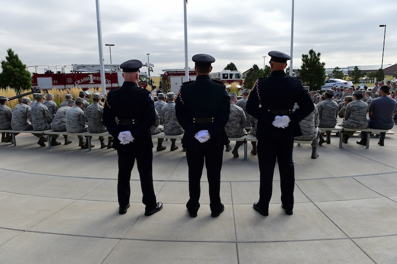 Members of the Aurora Police Department Honor Guard observe Patriot Day with Team Buckley members Sept. 11, 2015, at the Headquarters Building on Buckley Air Force Base, Colo. Patriot Day is the national day of service and remembrance, in memory of the thousands killed on U.S. soil in the 9/11 attacks. (U.S. Air Force photo by Senior Airman Phillip Houk/Released)