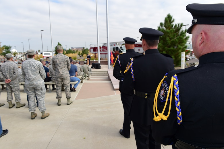 Members of the Aurora Police Department Honor Guard prepare to raise the U.S. flag during the Patriot Day Ceremony Sept. 11, 2015, at the Headquarters Building on Buckley Air Force Base, Colo. Patriot Day is the national day of service and remembrance, in memory of the thousands killed on U.S. soil in the 9/11 attacks. (U.S. Air Force photo by Senior Airman Phillip Houk/Released)
