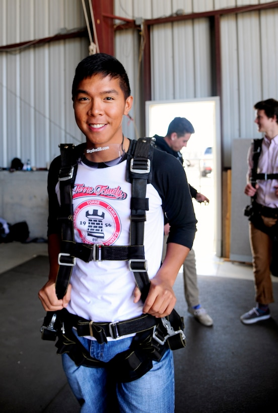 Airman 1st Class Jerzees Fernandez, 30th Civil Engineer Squadron electrical system journeyman, awaits to sky dive, Sep. 5, 2015, Lompoc Airport, Calif. Single Airman Initiative organizes monthly activities that provide Airmen the opportunity to explore the area and meet new people. (U.S. Air Force photo by Senior Airman Kyla Gifford/Released)