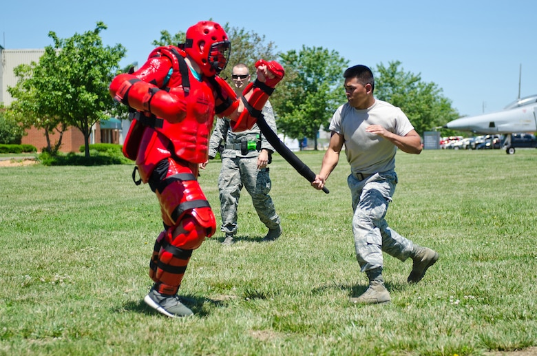 Senior Airman Reymart Relos (right), a services technician for the 123rd Force Support Squadron, attacks a 123rd Security Forces Squadron member during baton training as part of a week-long course for security forces augmentees at the Kentucky Air National Guard Base in Louisville, Ky., May 19, 2015. The course is designed to train Airmen from other career fields to perform base security functions, providing a pool of Airmen to assist the 123rd Security Forces Squadron during shortfalls in manning due to emergencies. (U.S. Air National Guard photo by Master Sgt. Phil Speck)