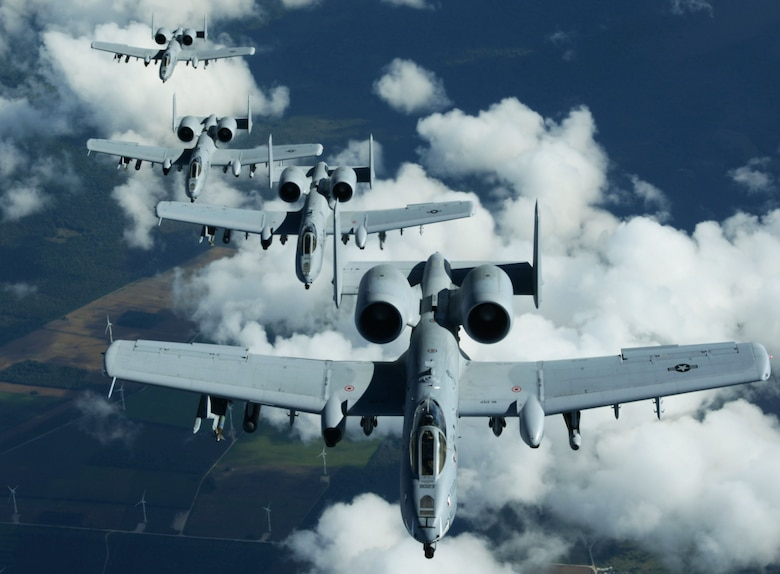 "A-10 Thunderbolt IIs from Whiteman Air Force Base, Missouri, get into formation, Sept. 9, 2015, after receiving fuel from a KC-135 Stratotanker assigned to RAF Mildenhall, England, over Estonia. The A-10s, commonly known by its nickname ""Warthog,"" deployed and participated in the air refueling in support of a NATO-led operation.  (U.S. Air Force photo by Airman 1st Class Justine Rho/Released)"