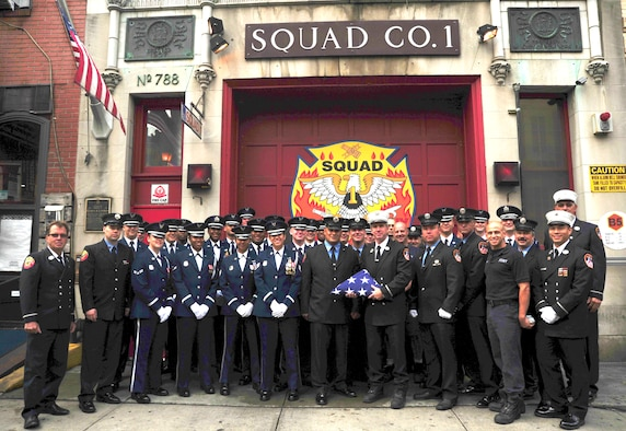 Members of the United States Air Force Honor Guard pose for a photo with New York City Fire Department Squad Company 1 on Sept.11, 2015 in New York City, N.Y.  The Honor Guard presented the squad with an American flag to honor them as first responders on 9/11. (U.S. Air Force courtesy photo/Airman 1st Class Latasia Gross)