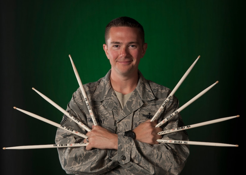 Tech. Sgt. Josh Tarrant, Joint Space Operations Center laser clearinghouse NCO in charge, poses for a portrait with his drum sticks Sept. 2, 2015, Vandenberg Air Force Base, Calif. Tarrant is an avid drummer and has merged his two passions, the military and music, by becoming involved with Tops in Blue. (U.S. Air Force photo by Airman 1st Class Ian Dudley/Released)