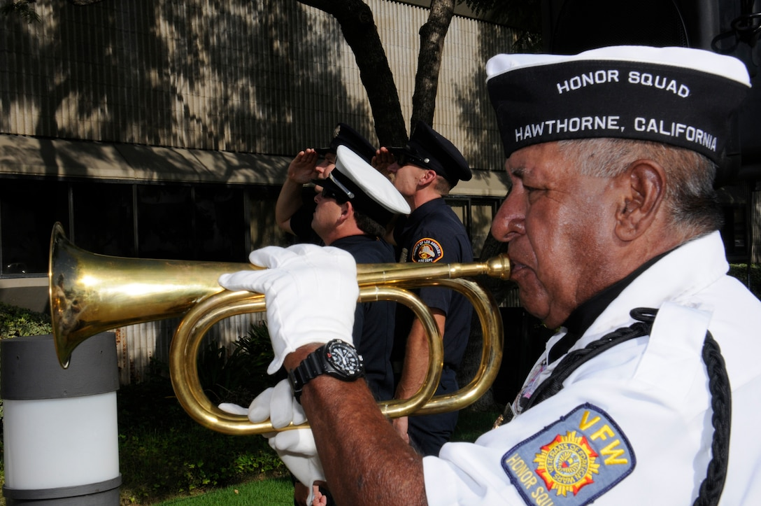 A VFW Honor Squad member plays taps at the City of Hawthorne's annual 9-11 ceremony. (Photo by Joe Juarez)