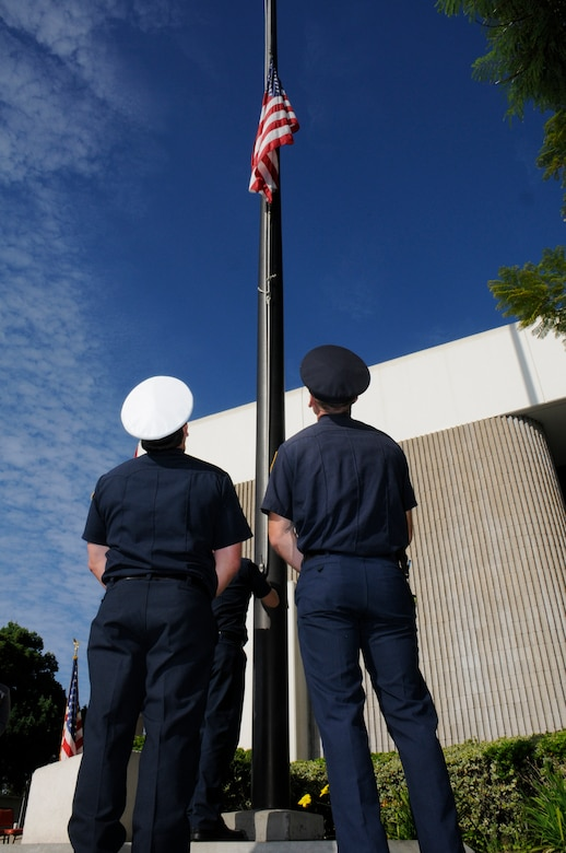 A flag flies at half-staff in front of the Hawthorne City Hall in honor of those who lost their lives on Sept. 11, 2001. (Photo by Joe Juarez)