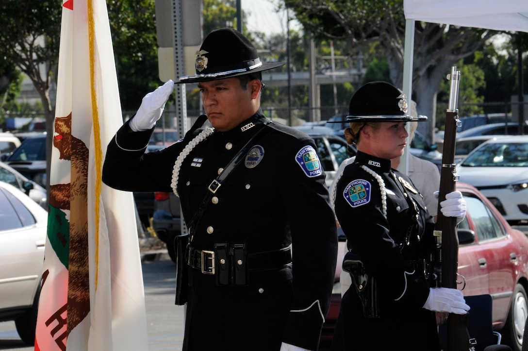 An Honor Guard from the Hawthorne Police Department salutes the colors at the start of the city's 9-11 ceremony. (Photo by Joe Juarez)