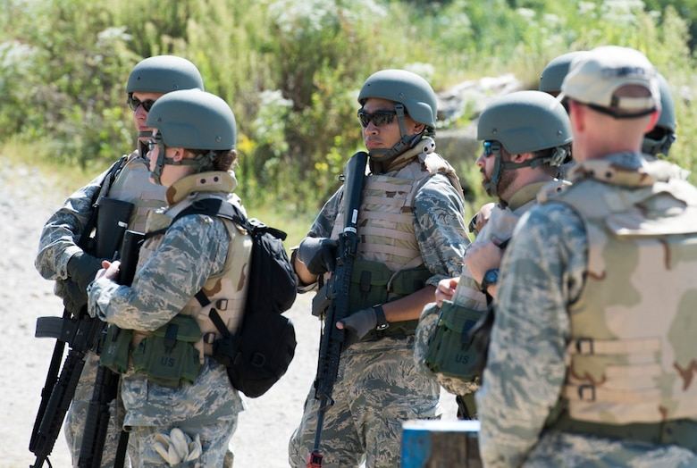 Participants in the Air Force Research Laboratory 2015 Tech Warrior exercise learn some of the basics of running an entry control point, Sept. 10, 2015, at the National Center for Medical Readiness, Fairborn, Ohio. During the exercise participants are learning a variety of skills such as base defense, self-aide buddy care, tactical vehicle driving and land navigation. (U.S. Air Force photo by Wesley Farnsworth / Released)