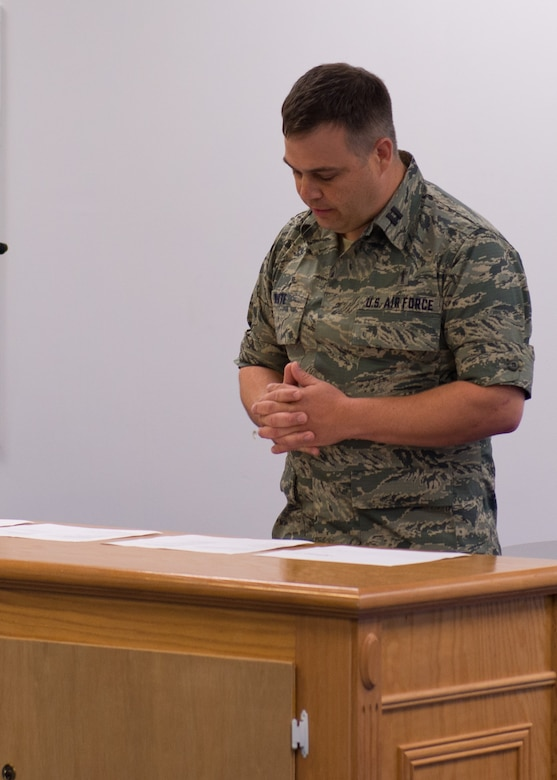 Capt. Derek White, Chaplain 102nd IW speaks to members of the 102nd during a 9/11 morning's service. By Staff Sgt. Veuril McDavid