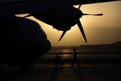 A U.S. Airman assigned to the 774th Expeditionary Airlift Squadron completes a preflight inspection on a C-130J Super Hercules aircraft at Bagram Airfield, Afghanistan, Sept. 12, 2015. The Airman and the rest of his squadron were in the process of redeploying back to Little Rock Air Force Base after successfully completing their deployment. During their rotation as the 774th Expeditionary Airlift Squadron, the Little Rock team completed 1,850 combat sorties and moved 14,500 passengers and 17 million pounds of cargo.  (U.S. Air Force photo by Tech. Sgt. Joseph Swafford/Released)