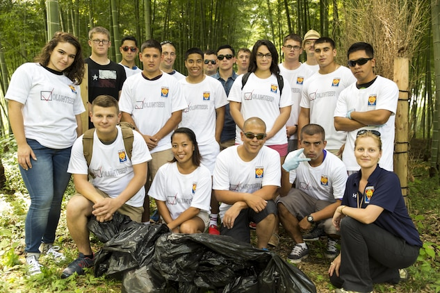 Volunteers pose for a group photo after picking up trash at the Kintai-area in Iwakuni, Japan, during a community relations event hosted by the Single Marine Program aboard Marine Corps Air Station Iwakuni, Japan, Sep. 4, 2015. Approximately 24 volunteers spent more than two hours picking up litter along the side of the road.
