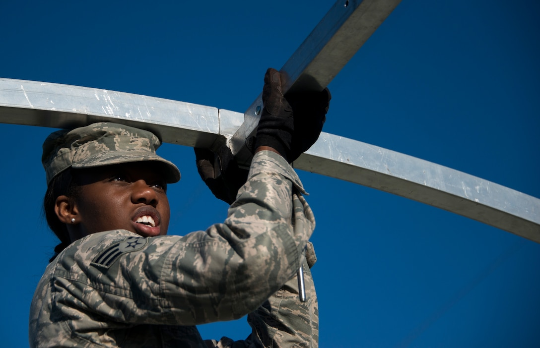 Senior Airman Charelle Baxter, 919th Special Operations Force Support Squadron, inserts a beam during small shelter system training at Duke Field, Fla., Sept. 13. The shelter takes six fully trained personnel approximately three and a half hours to complete. The SSS training is part of annual home station readiness training for all members of the squadron. (U.S. Air Force photo/ Tech. Sgt. Jasmin Taylor)