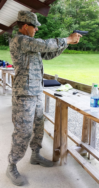 Maj. Peter Grossenbach, C-17 Globemaster III pilot with the 728th Airlift Squadron, performs pistol training during the Team USA Military training camp in Burlington, Vermont, in July. After trying out and qualifying for the team, Grossenbach went on to compete in the Interallied Confederation of Reserve Officers, or CIOR, military competition in Shumen, Bulgaria, Aug. 3-9. He represented the U.S. as part of an international team and won third place in the novice category. The pentathlon consists of: pistol shooting, rifle shooting, 500-meter land obstacle course, 50-meter water obstacle course, and up to a 15-kilometer orienteering, or land-navigation, event that also encompasses combat first aid. According to the CIOR Web site, the competition focuses on military skills that truly challenge the leadership and physical robustness of reservists. (U.S. Air Force Reserve photo by Maj. Mike Masuda)