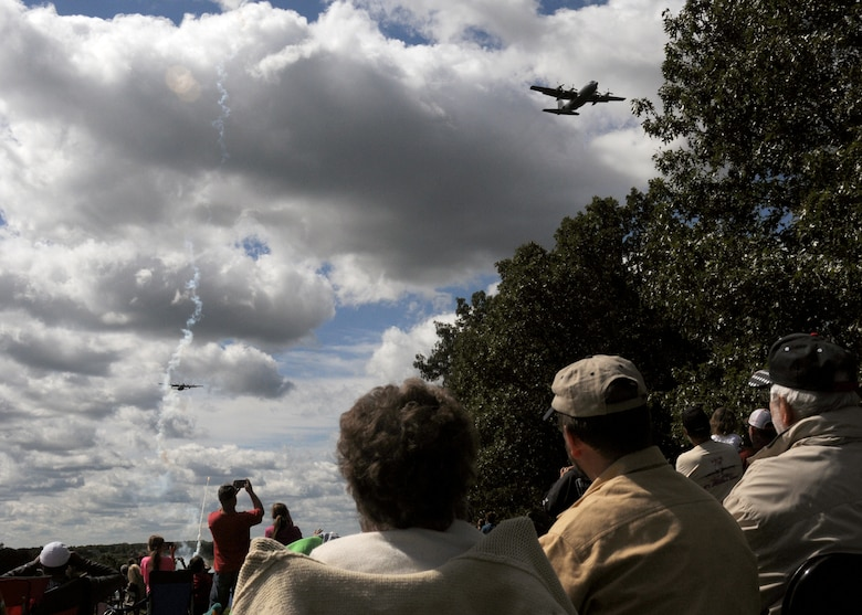 Central Missouri community members watch as C-130 aircraft of the 139th Airlift Wing fly over an outreach event hosted by the Missouri Air National Guard's 131st Bomb Wing, Detachment 1 - Cannon Range, near Laquey, Missouri, Sept. 12, 2015.  More than 850 guests participated in the family-friendly event that included munitions demonstrations by the B-2 Spirit stealth bomber, A-10 Thunderbolt II attack aircraft, and C-130 Hercules transport. (U.S. Air National Guard photo by Senior Airman Nathan Dampf)