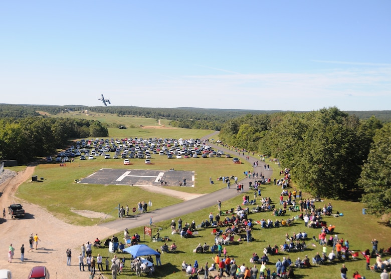 Central Missouri community members watch as A-10 fighter aircraft of the 442nd Fighter Wing fly over an outreach event hosted by the Missouri Air National Guard's 131st Bomb Wing, Detachment 1 - Cannon Range, near Laquey, Missouri, Sept. 12, 2015.  More than 850 guests participated in the family-friendly event that included munitions demonstrations by the B-2 Spirit stealth bomber, A-10 Thunderbolt II attack aircraft, and  C-130 Hercules transport. (U.S. Air National Guard photo by Senior Airman Nathan Dampf)