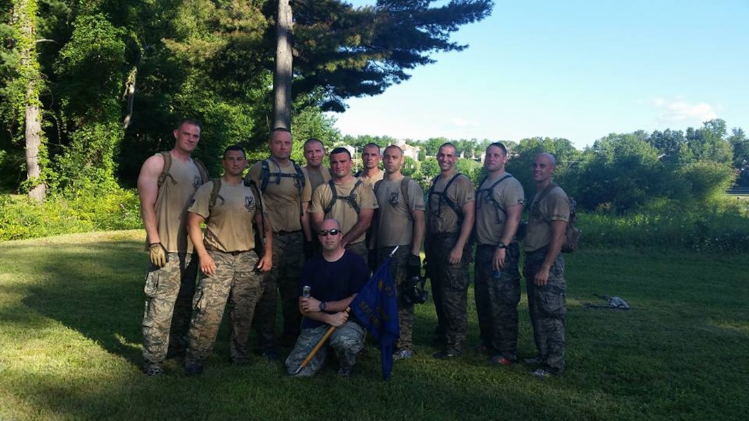 The 2015 103rd Security Forces Squadron SWAT Challenge team poses for a group shot following a grueling challenge part of the annual CT SWAT Challenge at two venues, the State Police Metacon Range in Simsbury and the MDC Reservoir in West Hartford, Conn., Sept. 17-21, 2015.