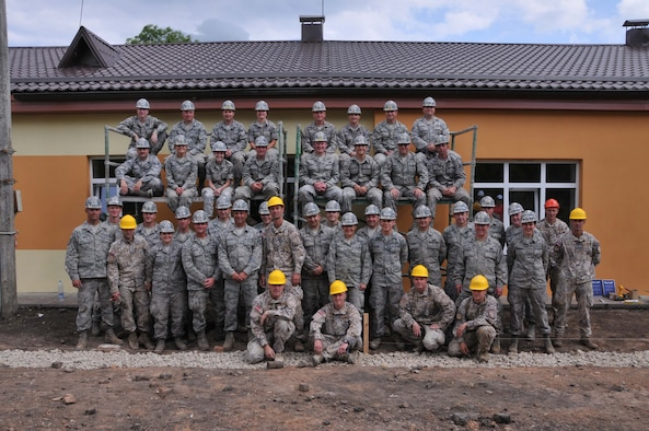 Members of the 171st Air Refueling Wing Engineer Squadron team pose with soldiers from the Latvian Army at the Naujene Orphanage in Latvia. Both groups have been remodeling a building st the orphanage as part of a Humanitarian Civic Assistance project. (Photo Courtesy of Kristina Isate, Latvian Embassy)
