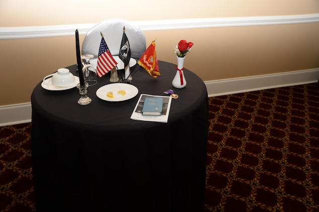 A table is set to honor captured and missing victims during Marine Corps Logistics Base Albany's POW-MIA Prayer Breakfast. The event was held at the Town and Country Restaurant's Grand Ballroom, recently.