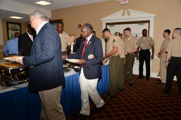 Base officials, Marines and visitors prepare to dine during Marine Corps Logistics Base Albany's annual POW-MIA Prayer Breakfast. The ceremony, which was held on base recently, commemorated our nation's captured and/or missing service members.