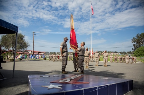 U.S. Marine Corps Brig. Gen. Daniel D. Yoo,  1st Marine Division Commanding General, relinquishes command to Maj. Gen. Daniel J. O'Donohue during a change of command ceremony on Marine Corps Base Camp Pendleton, Calif., Sept. 10, 2015. The ceremony signifies the transfer of responsibility and authority of 1st Marine Division between Commanding Generals. (U.S. Marine Corps photo by Sgt. Luis A. Vega, 1st Marine Division Combat Camera/Released)