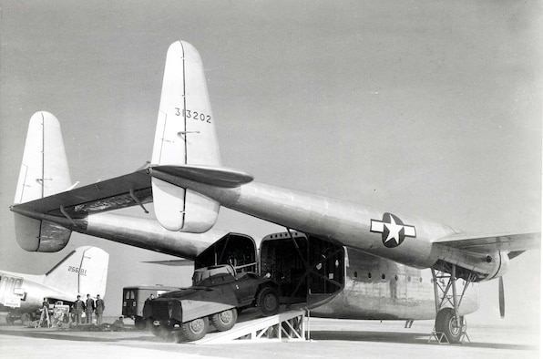 With its rear, clamshell doors opened wide, the C-82 displays its ability to load heavy cargo easily and quickly during a demonstration in October 1944. (U.S. Air Force photo)