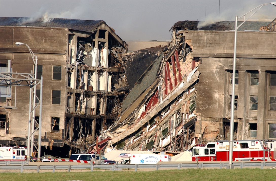 A 200-foot gash exposes interior sections of the Pentagon following a suspected terrorist crash of a commercial airliner into the southwest corner of the building. Part of the building has collapsed meanwhile firefighters continue to battle the flames and look for survivors. An exact number of casualties are unknown. The building was evacuated, as were the federal buildings in the Capitol area, including the White House. (U.S. Navy Photo/Photographers Mate 2nd Class Bob Houlihan)