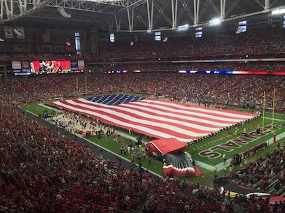 Marines with CLR 15 present the American flag at the Arizona Cardinals opening game, closing out Marine Week Phoenix in style.