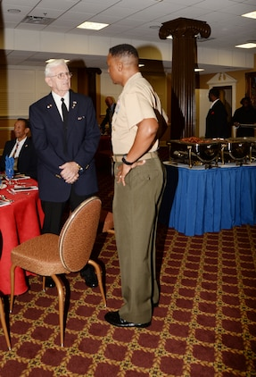 Maj. Gen. Craig C. Crenshaw, commanding general, Marine Corps Logistics Command, speaks with a visitor during the annual POW-MIA Prayer Breakfast held at Marine Corps Logistics Base Albany's Town and Country Restaurant's Grand Ballroom, recently.