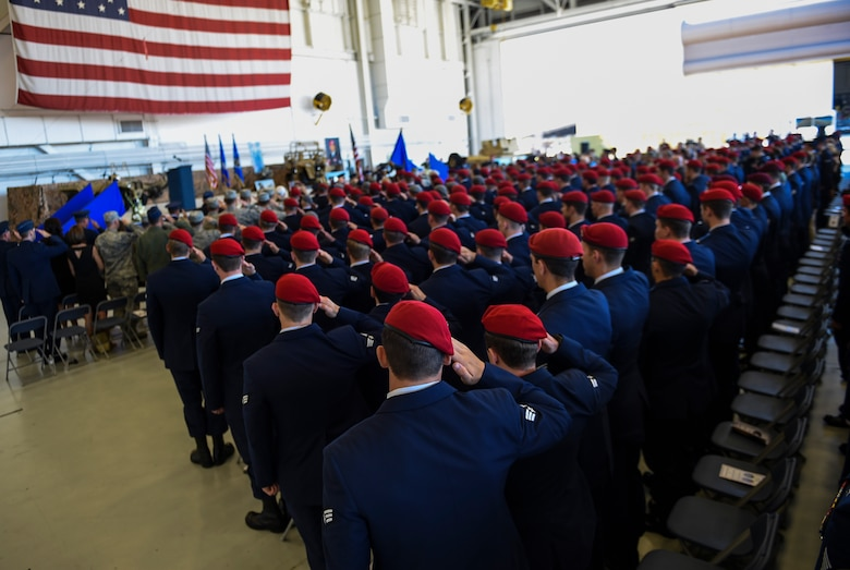 Airmen salute during Capt. Matthew D. Roland and Staff Sgt. Forrest B. Sibley's memorial service, Sept. 14, 2015, at Hurlburt Field, Fla. More than 1,000 friends and family members from across the country gathered together to mourn the loss of Roland, a special tactics officer from 23rd Special Tactics Squadron, and Sibley, a combat controller from the 21st Special Tactics Squadron. (U.S. Air Force photo by Senior Airman Ryan Conroy/Released)