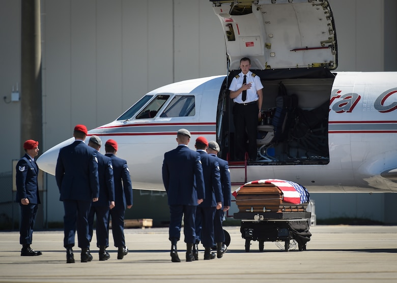 Special Tactics Airmen prepare to transfer the remains of Staff Sgt. Forrest B. Sibley on Hurlburt Field, Fla., Sept. 14, 2015. (U.S. Air Force photo by Airman Kai White/Released)