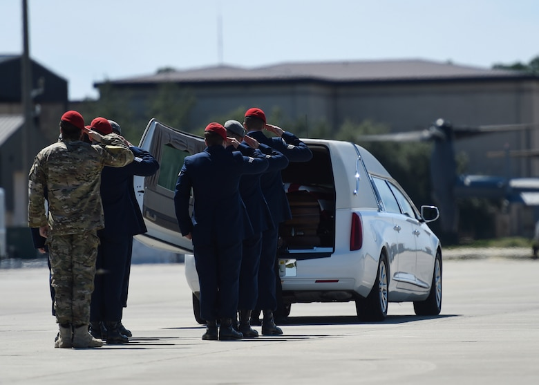 Special Tactics Airmen salute the remains of Staff Sgt. Forrest B. Sibley during a dignified transfer on Hurlburt Field, Fla., Sept. 14, 2015. The two Special Tactics Airmen, who had recently deployed to Afghanistan in support of Operation Freedom's Sentinel, were shot at a vehicle checkpoint at Camp Antonik, Afghanistan, Aug. 26, and died of wounds sustained in the attack, were honored in a private memorial.  Both Special Tactics Airmen will be buried with full military honors. (U.S. Air Force photo by Airman Kai White/Released)
