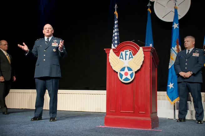 "Lt. Gen. James ""JJ"" Jackson, commander of the Air Force Reserve Command, gives remarks during the unveiling ceremony of the painting ""That Others May Live"" during the Air Force Association Air and Space Conference and Technology Exposition, Washington D.C., Sept. 14, 2015. ""That Others May Live"" documents the rescue of Marcus Luttrell, a U.S. Navy SEAL, in June 2005 by reservists from the 920th Rescue Wing, Patrick Air Force Base, Fla. The well-known rescue was dramatized in the movie""The Lone Survivor."" (U.S. Air Force photo/Staff Sgt. Kat Justen)"