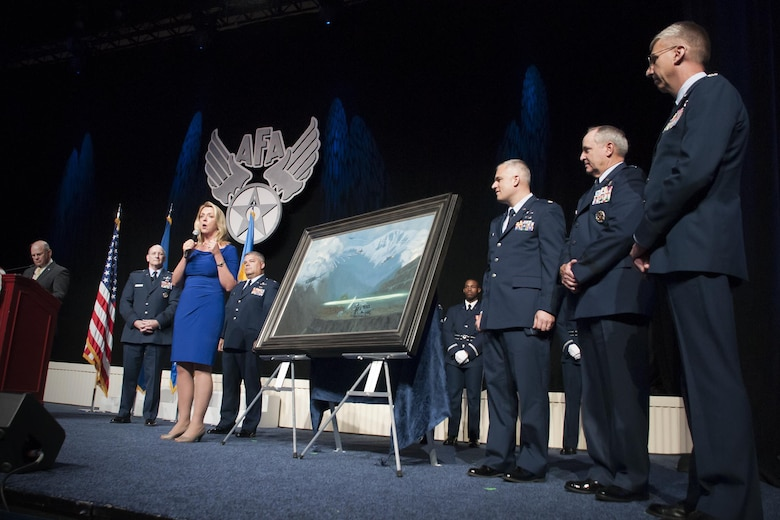 "Air Force Secretary Deborah Lee James gives remarks during the unveiling ceremony of the painting ""That Others May Live"" during the Air Force Association Air and Space Conference and Technology Exposition, Washington D.C., Sept. 14, 2015. ""That Others May Live"" documents the rescue of Marcus Luttrell, a U.S. Navy SEAL, in June 2005 by Reservists from the 920th Rescue Wing, Patrick Air Force Base, Fla. The well-known rescue was dramatized in the movie ""The Lone Survivor."" (U.S. Air Force photo/Staff Sgt. Kat Justen)"