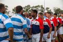 U.S. Marines with 1st Battalion, 4th Marine Regiment, Marine Rotational Force – Darwin, and members of the Darwin Stray Cats social rugby club shake hands before the start of the 9/11 memorial rugby match at the Defence Establishment Berrimah rugby field, Northern Territory, Australia Sept. 11. The annual match was established with the first game played between the 15th Marine Expeditionary Unit and the Stray Cats on Sept. 11, 2001, right before the terrorist attacks, and has become a commemorative match for each rotation of MRF-D. Participating in the match was an excellent opportunity to improve Marines' knowledge of Australian culture and ultimately strengthened our bond as allies.