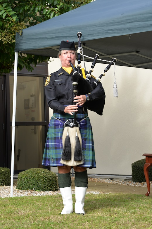 """Deputy Kathy McCurdy of the Bay County Sherriff's Office plays """"Amazing Grace"""" during the 9/11 remembrance ceremony at the 601st Air Operations Center Sept. 11. The ceremony was held to honor and remember all who were affected by the tragic events of that day. (Air Force photo released/Capt. Jared Scott)"""