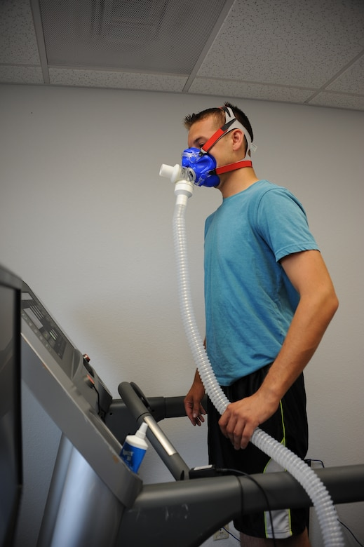 U.S. Air Force Senior Airman Yevgeniy Sokolov, 355th Aircraft Maintenance Squadron crew chief, stands on a treadmill in preparation to start a VO2 max test at the Health and Wellness Center at Davis-Monthan Air Force Base, Ariz., Sept. 2, 2015. The VO2 max measures the maximum amount of oxygen the body is able to use during a period of intense exercise depending on the subject's weight and the strength of their lungs. (U.S. Air Force photo by Airman 1st Class Ashley N. Steffen/Released)