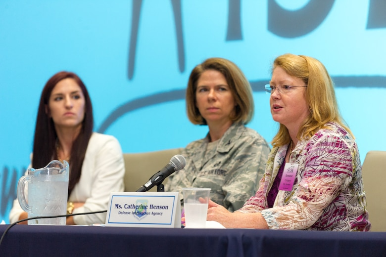 (From left to right) Dr. Dana Joseph of the University of Central Florida and Col. Shannon Klug of Patrick Air Force Base's 45th Weather Squadron, listen to Catherine Henson from the Defense Intelligence Agency answer questions during a panel discussion at the Air Force Technical Applications Center's 2nd Annual Women in STEM Symposium, Aug. 20, 2015.  The purpose of the event was to encourage diversity in the fields of science, technology, engineering and math by providing inspirational speakers and holding engaging discussions for both women and men in and outside the federal government.  (U.S. Air Force photo by Cory Long)