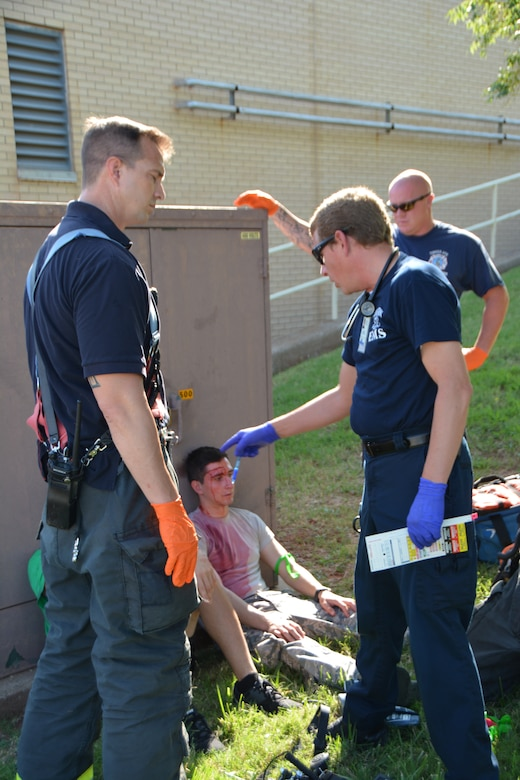 First responders tend to injured victims during the active shooter exercise Aug. 11th, 2015, at Tinker Air Force Base, Okla. Realistic disaster scenarios such as these allow medical personnel and base employees the opportunity to put their training into action. (U.S. Air Force photo by Tech. Sgt. Lauren Gleason)