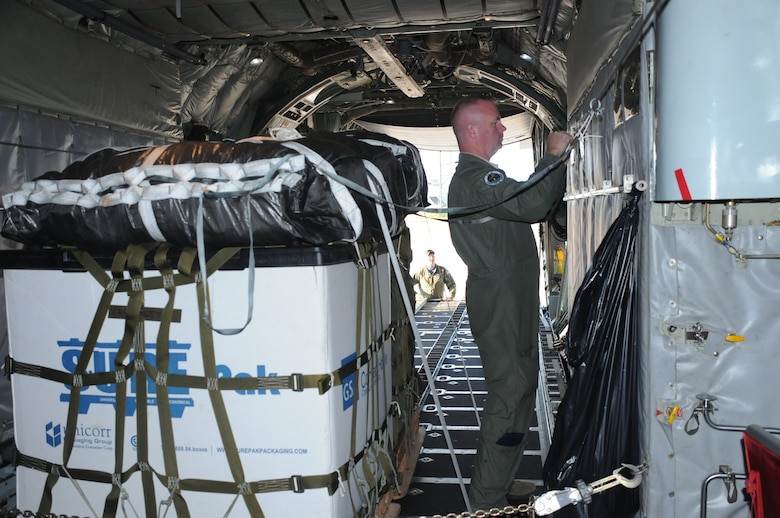 Staff Sgt. Pat Englishby (front), loadmaster, 328th Airlift Squadron, secures an palette inside a C-130 Hercules aircraft while Senior Airman Ken Zidell, loadmaster, 328 AS assists, at Ramstein Air Base, Germany, on Aug. 21, 2015. Englishby and Zidell were participating in Exercise Swift Response, a multinational training exercise. (U.S. Air Force photo by Staff Sgt. Matthew Burke/released)