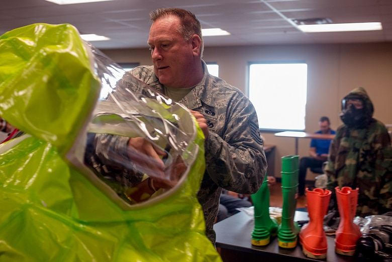 Tech Sgt. Tim Cotterall, 137th Civil Engineering Squadron emergency management specialist demonstrates hazardous materials safety equipment at Deer Creek Middle School, Edmond, Okla. on September 8, 2015. Tech Sgt. Cotterall spends time every September educating the students on the  hazardous materials in the home that can cause serious injury. (U.S. Air National Guard photo by Master Sgt. Andrew LaMoreaux/Released)