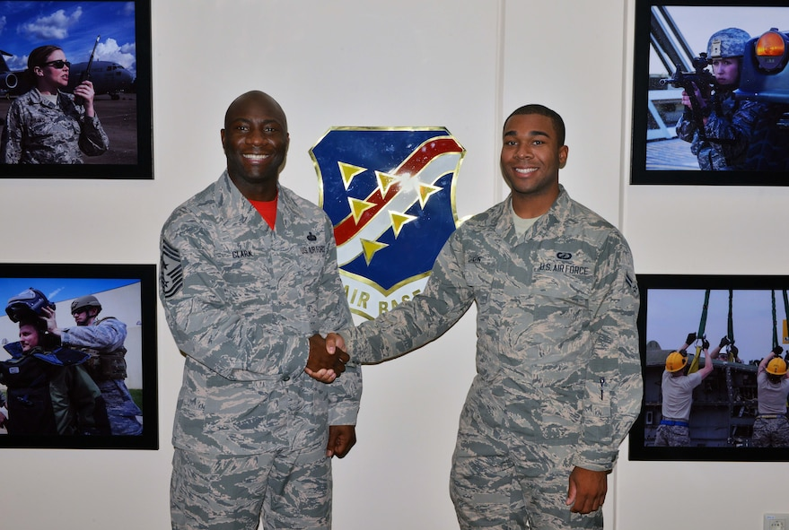 Chief Master Sgt. Vegas Clark, 39th Air Base Wing commander, poses for a photo with Airman 1st Class Justin Dixon, 39th Comptroller Squadron customer service apprentice, upon meeting him for his chief shadow day Sept. 11, 2015, at Incirlik Air Base, Turkey. Airmen are chosen for chief shadowing based on recommendation from their leadership due to their dedication to the mission and their job. (U.S. Air Force photo by Senior Airman Michael Battles/Released)