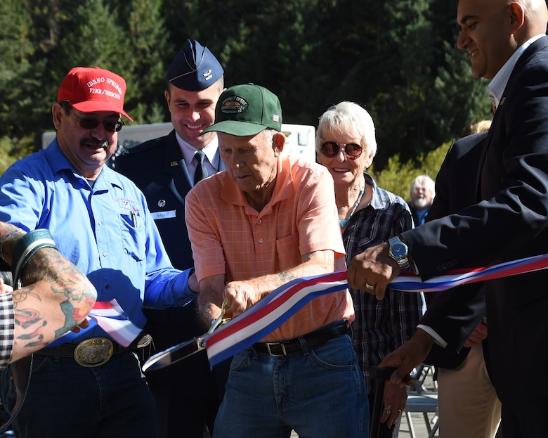 """""""Lefty"""" Yost, a Korean War veteran who helped build the original Twin Tunnels, cuts the ribbon during the Twin Tunnel re-naming ceremony Sept. 11, 2015, in Idaho Springs, Colo. Colorado State Legislature passed the bill in April 2015 to re-name the tunnels to recognize and remember the nation's military veterans. (U.S. Air Force photo by Airman 1st Class Samantha Meadors/Released)"""