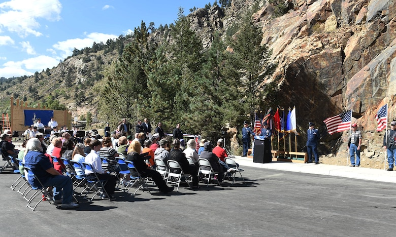 Col. John Wagner, 460th Space Wing commander, speaks to the audience during the I-70 Twin Tunnel re-naming ceremony Sept. 11, 2015, in Idaho Springs, Colo. Colorado State Legislature passed the bill in April 2015 to re-name the tunnels to recognize and remember the nation's military veterans. (U.S. Air Force photo by Airman 1st Class Samantha Meadors/Released)