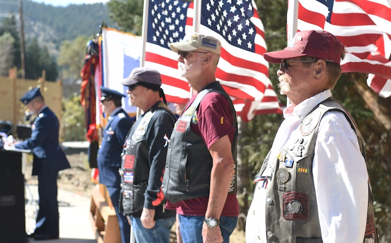 Colorado military veterans stand at attention while holding American Flags during the I-70 Twin Tunnel re-naming ceremony Sept. 11, 2015, in Idaho Springs, Colo. Colorado State Legislature passed the bill in April 2015 to re-name the tunnels to recognize and remember the nation's military veterans. (U.S. Air Force photo by Airman 1st Class Samantha Meadors/Released)