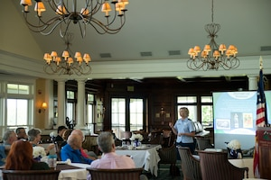 U.S. Air Force Lt. Col. Laura Caputo shares the history of the Vermont National Guard to the South Burlington Rotary Club at the Vermont National Golf Course in South Burlington, Vt., July 30, 2015. As part of the 158th Fighter Wing's Community Outreach Program, Caputo has given several presentations around the state to strengthen community relations and share the Vermont National Guard story. (U.S. Air National Guard photo by Airman 1st Class Jeffrey Tatro)