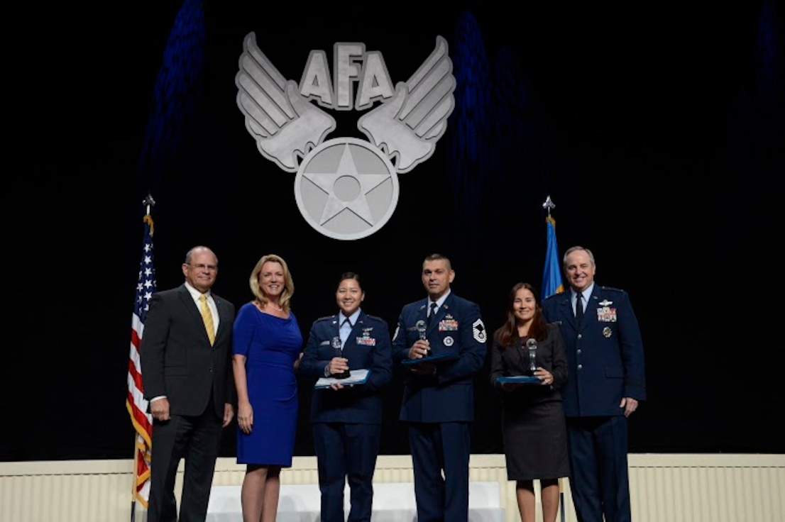 Air Force Association Chairman of the Board Scott Van Cleef, Secretary of the Air Force Deborah Lee James and Chief of Staff Gen. Mark A. Welsh III present the 2014 International Affairs Excellence Award to Lt. Col. Kathleen Le, Senior Master Sgt. Eric Gaona and Grisel Mundo-Love as part of opening ceremonies for the Air Force Association's 2015 Air and Space Conference and Technology Exposition Sept. 14, 2015, in Washington, D.C.  This was the first year the award has been split into four categories: officer, enlisted, senior civilian and junior civilian.  (U.S. Air Force photo/Scott M. Ash)